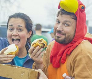 Couple eating cinnamon rolls at Chattanooga Hungry Turkey Half Marathon & 5K