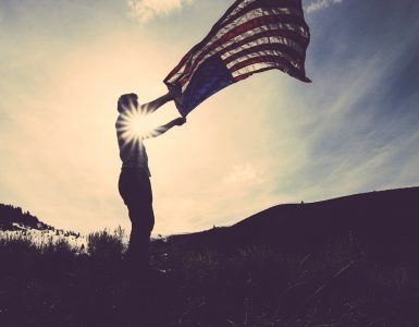Man waving American flag in the wind