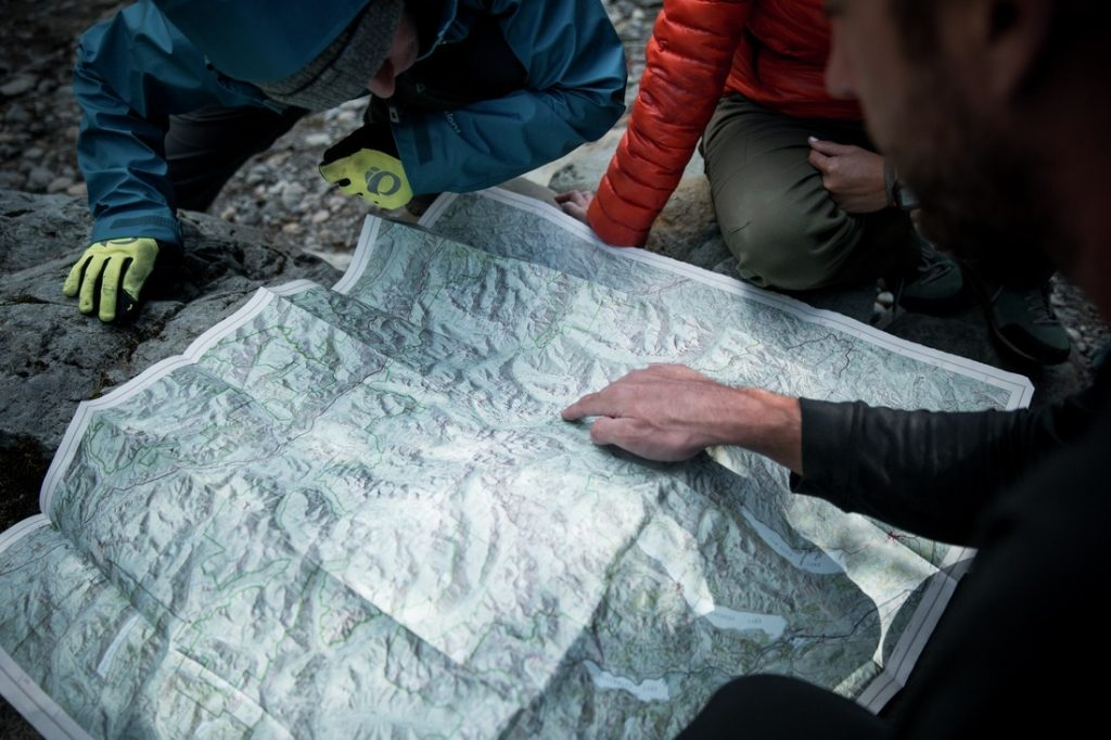 Group of hikers studying a map